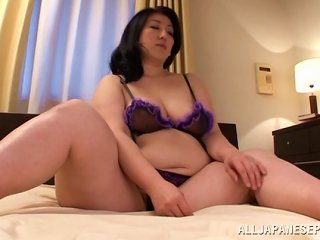 A Japanese Bbw Relaxes On Her Bed Rubbing Her Pussy